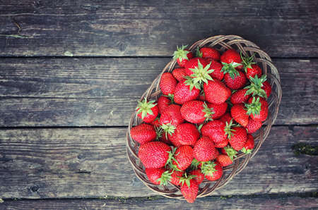 pawns: delicious fresh ripe and fragrant strawberries in a basket of wicker Sprig