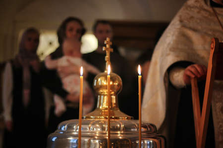 beeswax candle: church candles fire on ceremony of Epiphany in russian church