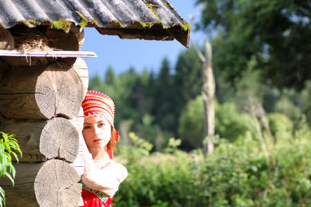 cute pretty girl in a traditional Slavic dress on nature in an unspoilt location Stock Photo