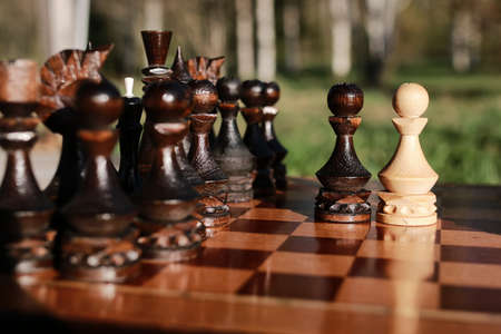 chessman: chess pieces arranged on the board mid-game in the fresh air Stock Photo