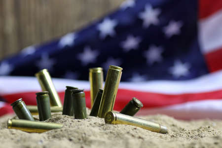 caliber: many shell casings from bullets of different caliber in the background chaos concept in the world Stock Photo