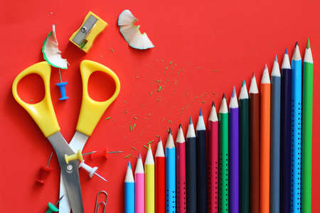 background for education concept scattered pencils and other stationery Stock Photo