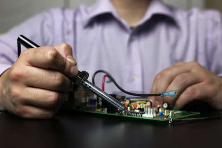 technology engineer of the modern world in a workflow with electronic devices Stock Photo