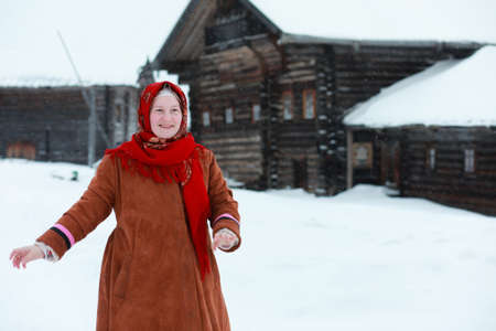 young girls in traditional costumes of the Russian north in wint