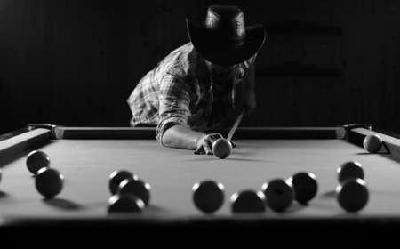 billiards hall: monochrome photo young man playing billiards