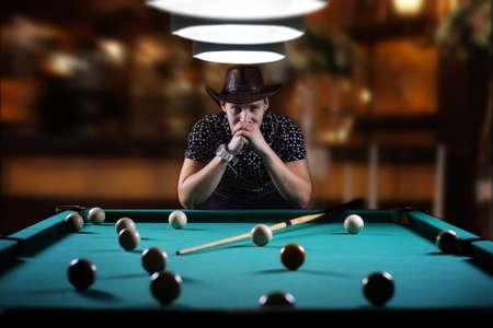 billiard: hansome man playing billiards alone