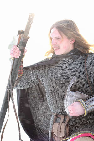 Defender the young warrior in mail armor armed with a sword