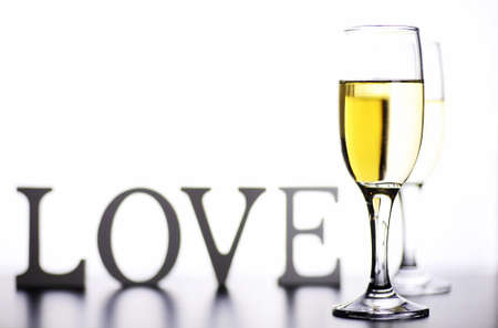 sauvignon blanc: glass of white wine on a table on a white background isolate