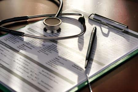 stethoscope medical documents pen