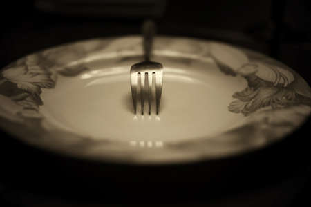 grunge flatware: toned fork in plate monochrome