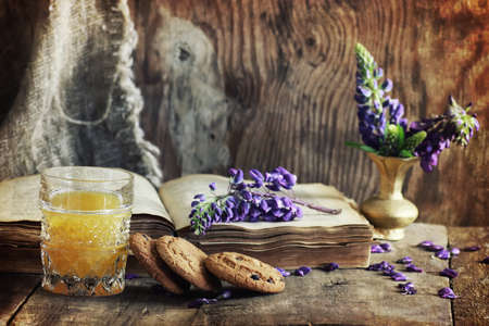 scratches effect on photo retro book on wooden drink breakfast Stock Photo
