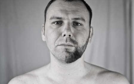 black appliances: monochrome textured portrait bearded man shaving