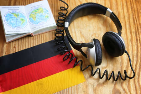 course language headphone and flag on a table
