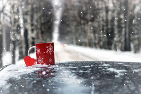 cup on a car in winter season Stock Photo