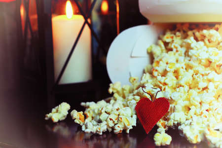 popcorn basket near candle Stock Photo