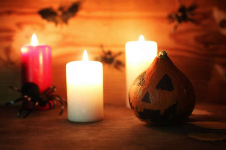 table decorations for Halloween carved pumpkin head candles Stock Photo