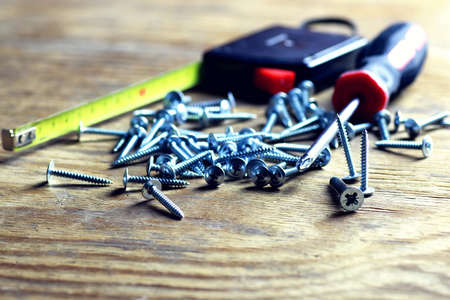 screws and screwdriver Roulette Stock Photo