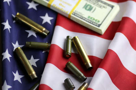 bullet and money on the american flag