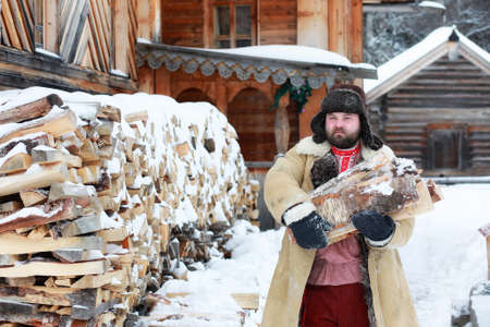 Traditional winter costume of peasant medieval age in russia Stock Photo