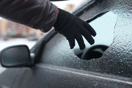 dirty car: man broke the glass of the car a little stone