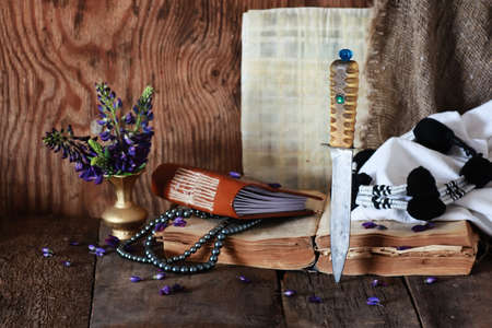 taliban: Arab book flower and knife