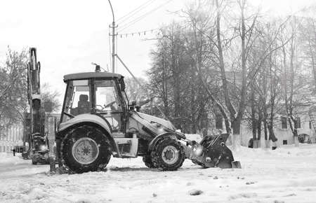 cleaning service: snow machine with a bucket outdoor street city