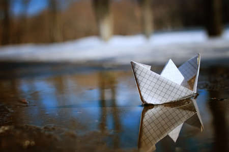 tinted photo paper boat on spring street Stock Photo