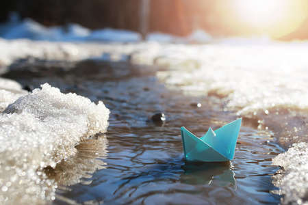 paper boat in a pool winter