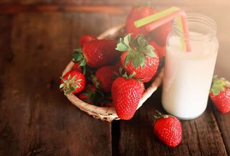 red straw: Fresh fragrant and juicy fruits on the wooden background image of a healthy diet