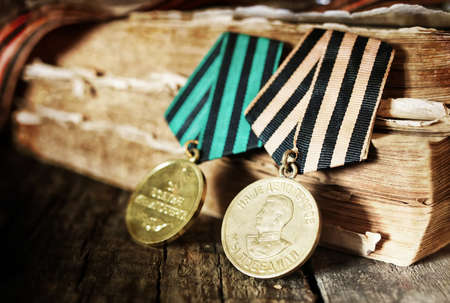 Awards of Merit in World War II by the Soviet Union on a vintage wooden background Stock Photo