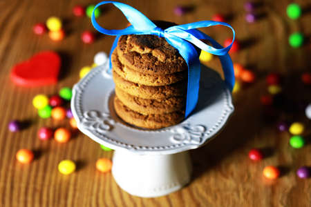 Cookies with ribbon on plate