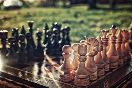 chess pieces arranged on the board mid-game in the fresh air Stock Photo