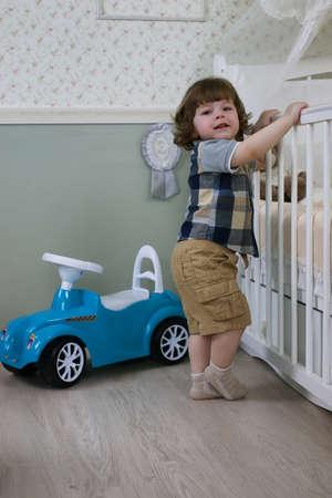 litle: litle boy sit on a toy car Stock Photo