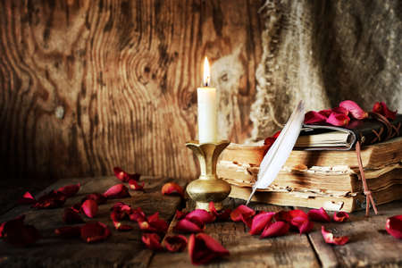Book pen candle romance Stock Photo - 76331407