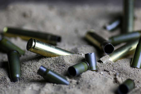 bullet in the sand Stock Photo