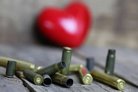 casings: many shell casings from bullets of different caliber in the background chaos concept in the world Stock Photo