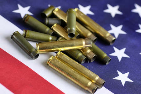 symbol victim: many shell casings from bullets of different caliber in the background chaos concept in the world Stock Photo