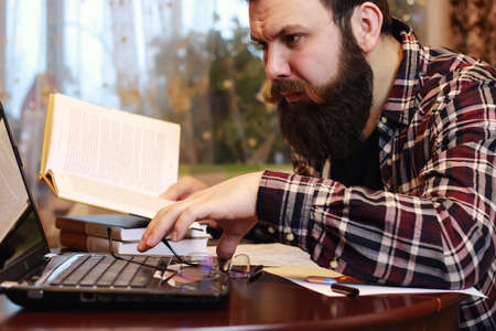 businessman working at his computer: male notebook work bearded