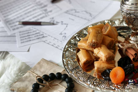 Eastern sweets table on a silver platter baklava and Tamarind snack at the workplace Stock Photo