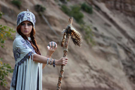 druid: cute pretty girl in ethnic dress in the wild at sunset