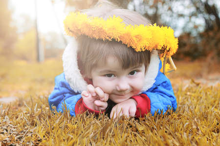 Little girl posing on camera walking in the autumn park Stock Photo
