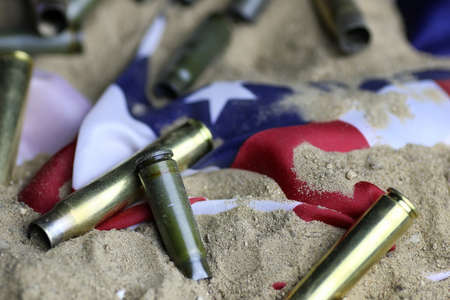 many shell casings from bullets of different caliber in the background chaos concept in the world Stock Photo