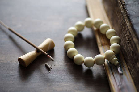 Beads and Incense on wooden table Banco de Imagens
