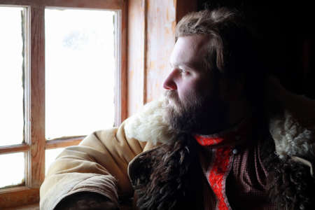 ukrainian ethnicity: man in traditional winter costume of peasant medieval age in rus Stock Photo