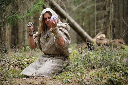 sotana: A man in a cassock spends a ritual in a dark forest