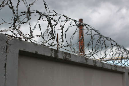 barbed wire fence: Security system using wire fences on the fence
