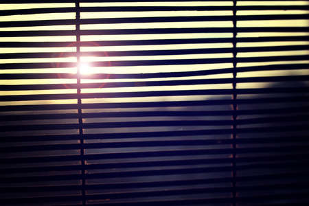 tough: the sun is shining through the blinds Stock Photo