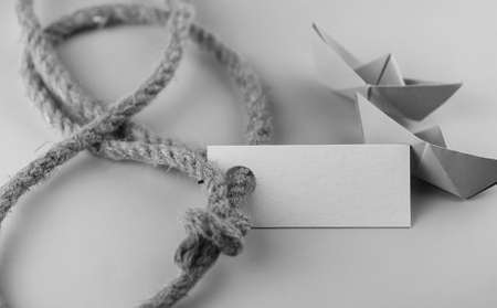 white sheet: white sticker with thick braided rope and ship paper origami