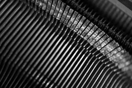 designer: Different small metal elements of an old typewriter macro