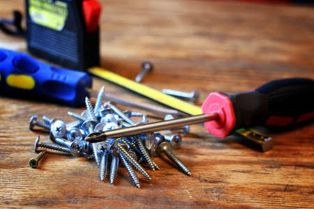 screws and screwdriver stack Stock Photo